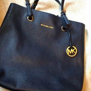 Navy blue Michael Kors bag.